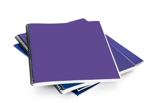 Photograph of a pile of reports for report writing