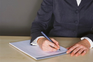 picture of lady drafting a legal document